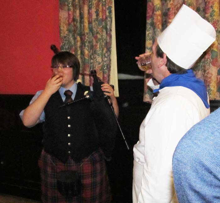 Piper and chef enjoy a dram